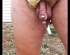 Wearing wife'_s yellow panties and peeing.