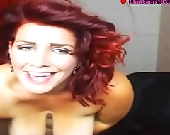 sexy redhead bbw milf dildoes while standing
