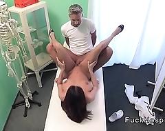 Busty patient sucks cock behind screen