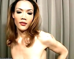 Lean redhead ladyboy with low hanging balls tugs two cocks