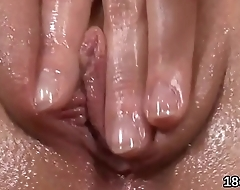Adorable cutie is gaping wet cunt in closeup and having orgasm