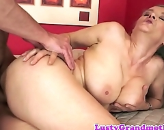 Busty grandmother screwed by younger cock