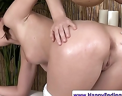 Oiled lesbian beauty fingered by masseuse