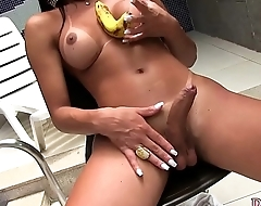 Shemale Erica Lee inserting a banana