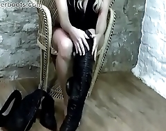 Busty blonde babe puts on leather ayah